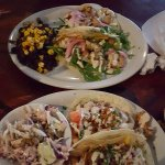 Grilled lemon shrimp tacos with black beans and rice; BBQ mahi tacos with slaw