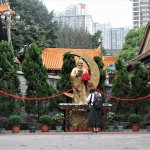 Statue of Yue Lao, the Matchmaker, with statues of a man and woman.