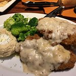 Chicken fried steak. Too much for one person. It was very very good.   The 12 oz ribeye my husba