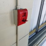 Feeling safe with an activated fire alarm pull station - but no alarm sounding, and dust on it..
