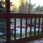 Balcony overlooking river that separates property from Fall River Road.