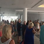 Hotel guests having to wait for the doors to be opened to the outside space, gym and pool area!