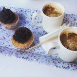 Vegan orange+chocolate cupcakes, coffee with soy milk.