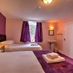 Room 106 - Double or Twin sleeps up to 3 - shower en-suite with sink in the room