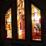 stain glass window in queen bee lounge and bedroom