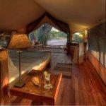 Warm tones and wood finish in Jongomero's tents