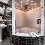 The Atelier Bathroom with big round V&B whirlpool, bathroom TV, rain shower, starlights...