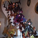 Witches sliding down the banister at Halloween