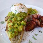 Smashed avocado with a side of bacon