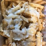 """soggy """"poutine""""....fake cheese and brutal fries."""