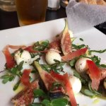 Fresh Fig and Mozzarella Salad with purslane, speck ham, basil, and honey vinaigrette