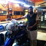The friendly owner with my bike inside the hotel. Thank you sir.