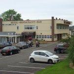 Car park with main reception & restaurant/bars behind