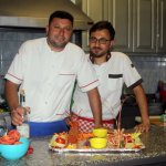 Chef and Assistant with Lobster Dish for two