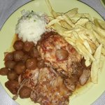 Rabbit stew with rice, fries and olives