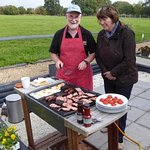 Guests enjoying their BBQ on the terrace of chalet barn