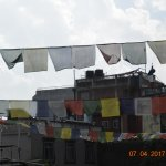 Prayer flags over the courtyard.