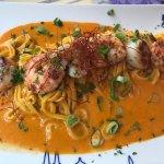 Panfried scallops, King prawns on fresh pasta with leek €26.50