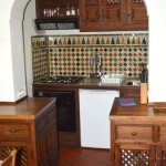 The functional kitchen with stove, oven, fridge etc.
