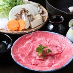 寿きやき SUKIYAKI it is boiled vegetable and beef with sweet soy soup.