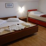 Triple room with additional (4th) bed and balcony and sea view
