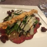Carpaccio of beef with rocket salad, parmesan cheese and pine nuts