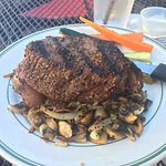 A perfect top sirloin with grilled mushrooms and onions.