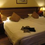 Double twin beds, huge but clean and well-tucked in...