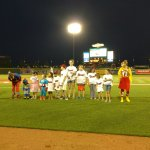 Kids singing during the 7th inning stretch.