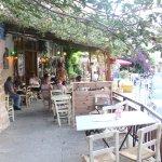 Sidewalk dining, raised above old Venetian street overlooking ruins of wall