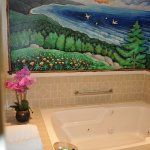 mural and jacuzzi tub in room #39 at Lone Oak Lodge