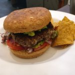 Black bean burger with chips and slaw
