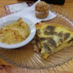 Sausage cheese quiche, hash brown casserole, muffin and a side of Trivial Pursuit