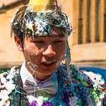 This Oxford student just completed final exams and is covered with whipped cream and confetti.