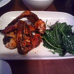 Spicy Chicken Wings with brasied greens