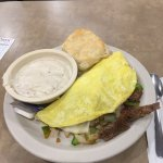 Philly cheese steak omelette with a side of gravy.