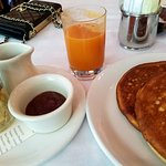 Ricotta pancakes, fruit, jam & carrot juice.