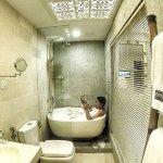 Enjoying bubble bath. FYI - all room have bathtub