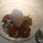 Vegan dessert: pear sorbet on a bed of fresh Dutch strawberries