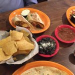 Tortilla chips, salsa, black beans, pico de gallo, burrito, tacos