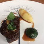 Ox cheek with confit garlic and snails
