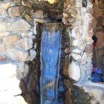 boiling fountain that runs through a rock shelter
