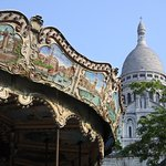 Sacre-Coeur with the merry-go-round in the foreground