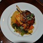 The pork chop came with cheddar polenta and grilled vegetables