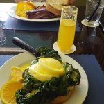 Soft poached eggs, hollandaise sauce, spinach and toast