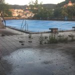 Hotel Thermal outdoor pool July 2016. Closed, with weeds growing.