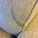 Large grease stain on couch in suite