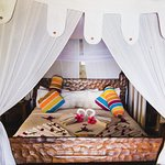 Beautiful wooden bed with a reliable mosquito net