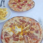 Fried egg & sausage pizza, with the 'hot' pizza in the background.