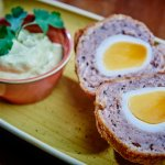 Homemade hen's Scotch egg, with curried mayonnaise, £6 garnished with coriander